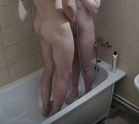 Satisfied Leah and her boyfriend showering after hot sex action