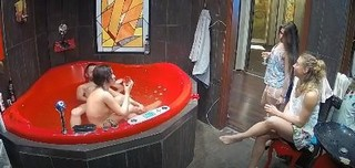 Courtney enjoying her friend, champagne and jacuzzi, April 20