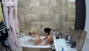 Young cutie Kalita has fun with her slender brunette friend in the shower